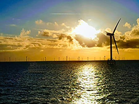 windfarm sunset over sea