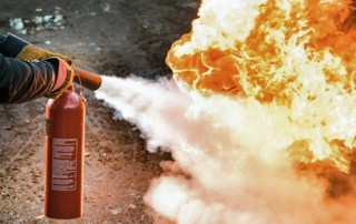 fire extinguiser dousing flames